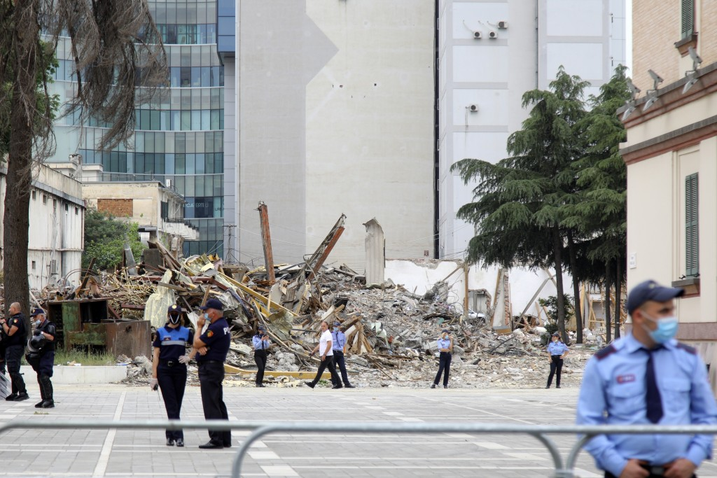 Police guard during the demolition of the national theater building in Tirana, Monday, May 18, 2020. Albanian artists and opposition party supporters ...