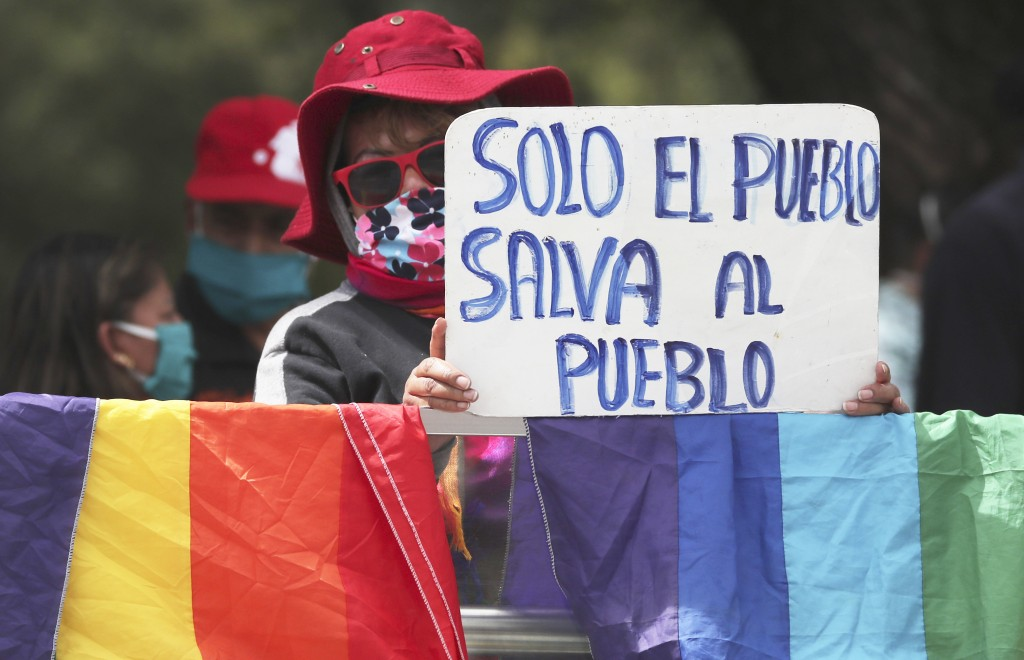 "A demonstrator holds a sign which reads in Spanish ""Only the people can save the people,"" during a protest called by multiple workers' unions against ..."
