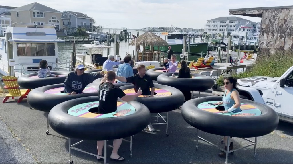 """In this image made from Saturday, May 16, 2020, video provided by Revolution Event Design & Production, """"bumper tables,"""" created by the company and de..."""