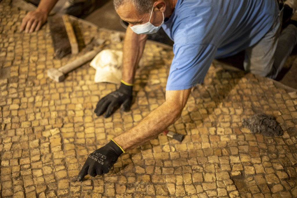 Israel Antiquities Authority archaeologists work at an excavation site, in Jerusalem's Old City, Tuesday, May 19, 2020. Israeli archaeologists excavat...