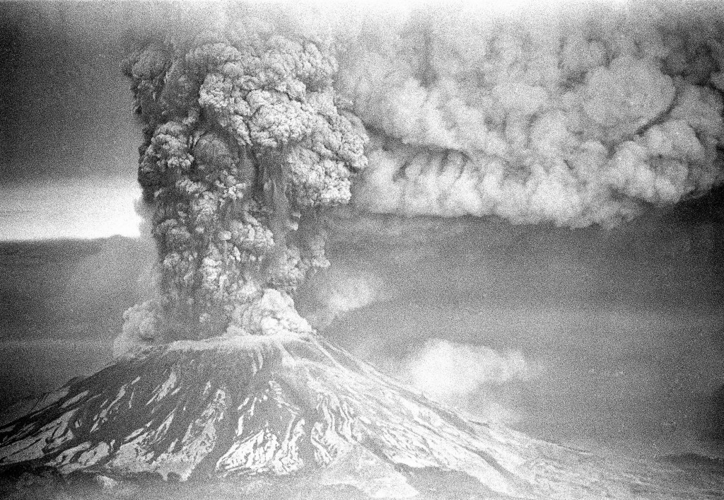 FILE - In this May 18, 1980, file photo, Mount St. Helens sends a plume of ash, smoke and debris skyward as it erupts.  May 18, 2020, is the 40th anni...