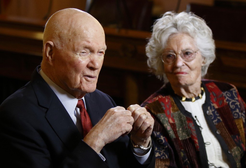FILE - In this May 14, 2015, file photo, former astronaut and U.S. Sen. John Glenn, D-Ohio, left, answers questions with his wife Annie Glenn during a...