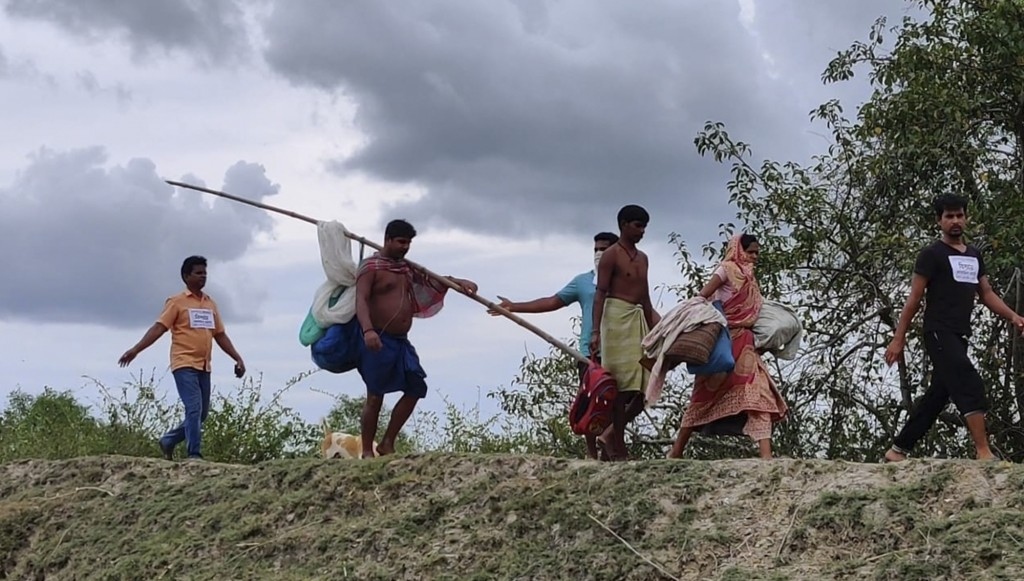 Villagers on the Bay of Bengal coast walk as they are evacuated by volunteers as a precaution against Cyclone Amphan at Bakkhali, South 24 Parganas, W...