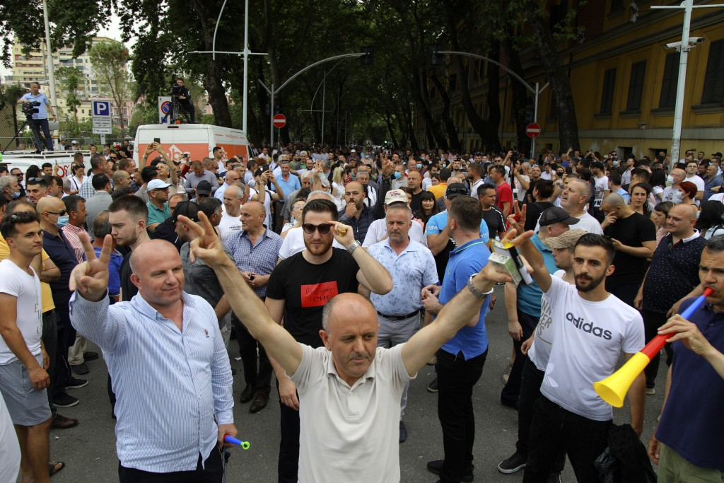 Protesters gather during a rally against the demolition of the national theater building as in Tirana, Monday, May 18, 2020. Albanian artists and oppo...
