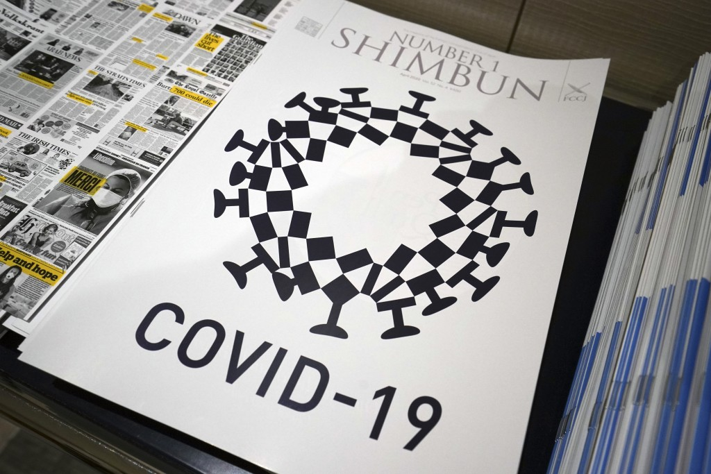 The cover design of Number 1 Shimbun is seen in Tokyo, Tuesday, May 19, 2020. Tokyo Olympics officials are incensed that their games emblem has been u...