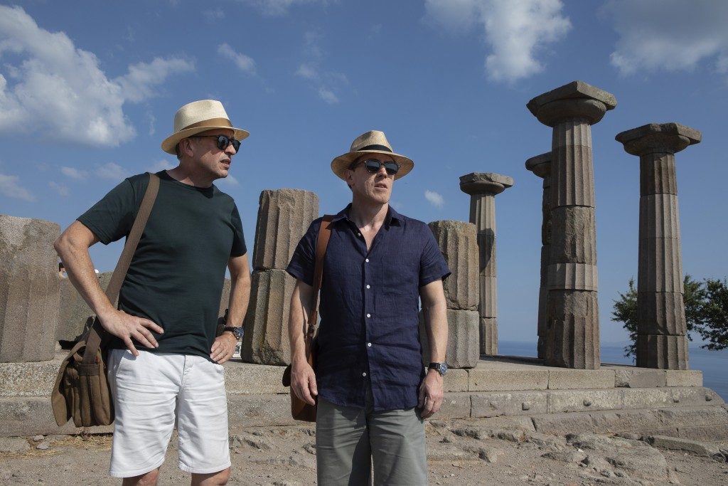 """This image released by IFC Films shows Rob Brydon, right, and Steve Coogan in a scene from """"The Trip to Greece,"""" available Friday for rent on VOD and ..."""