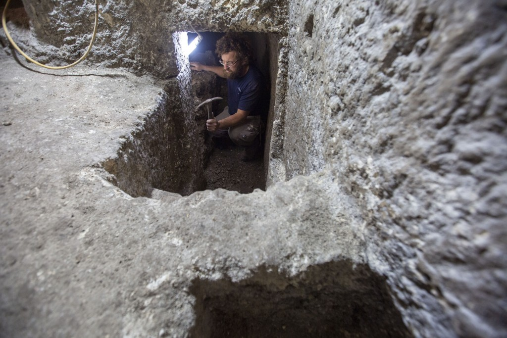 An Israel Antiquities Authority archaeologist works at an excavation site, in Jerusalem's Old City, Tuesday, May 19, 2020. Israeli archaeologists exca...