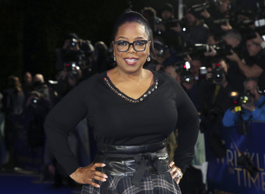 "FILE - In this March 13, 2018, file photo, actress Oprah Winfrey poses for photographers upon arrival at the premiere of the film ""A Wrinkle In Time"" ..."