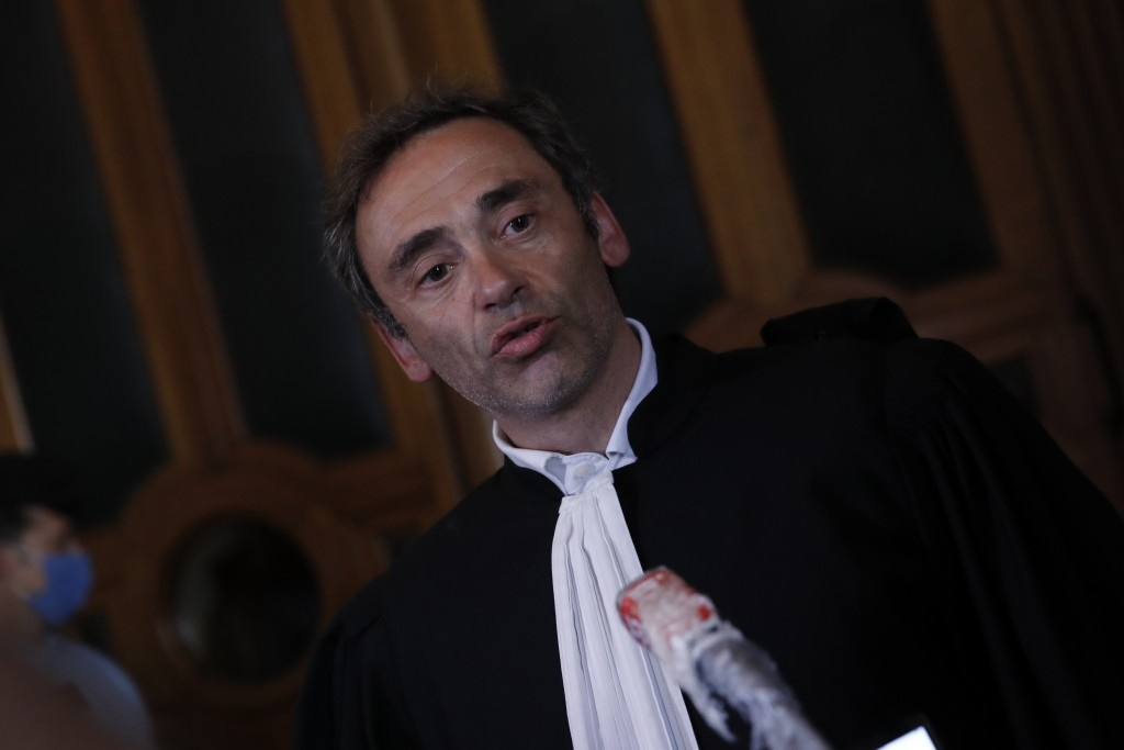 Laurent Bayon, one of Felicien Kabuga's French lawyers, speaks to reporters outside the courtroom, Wednesday, May 20, 2020 in Paris. Felicien Kabuga, ...