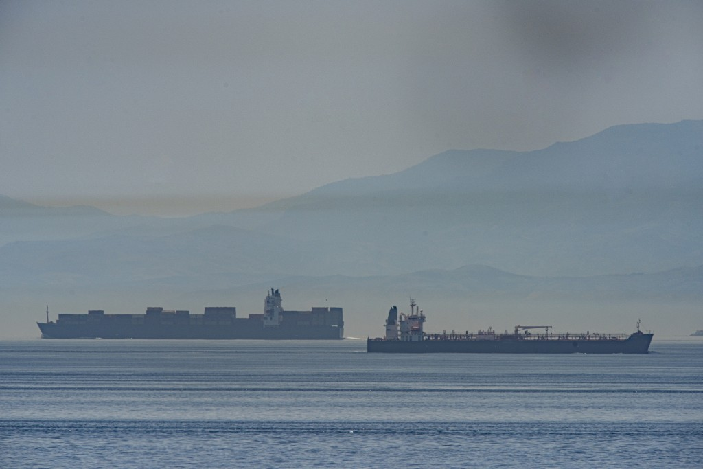 A view of the vessel the Clavel, right, sailing on international waters crossing the Gibraltar stretch on Wednesday, May 20, 2020. Five Iranian tanker...