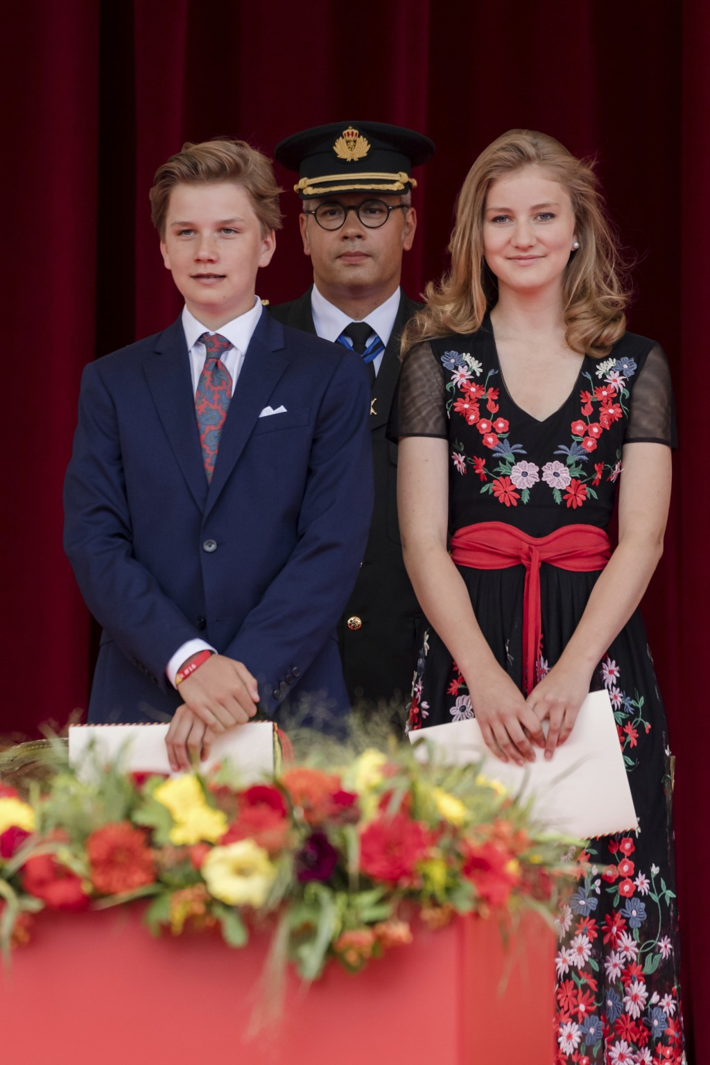 FILE - In this photo taken on Saturday, July 21, 2018, Crown Princess Elisabeth, right, and Belgian Prince Gabriel stand in the royal stand as they wa...