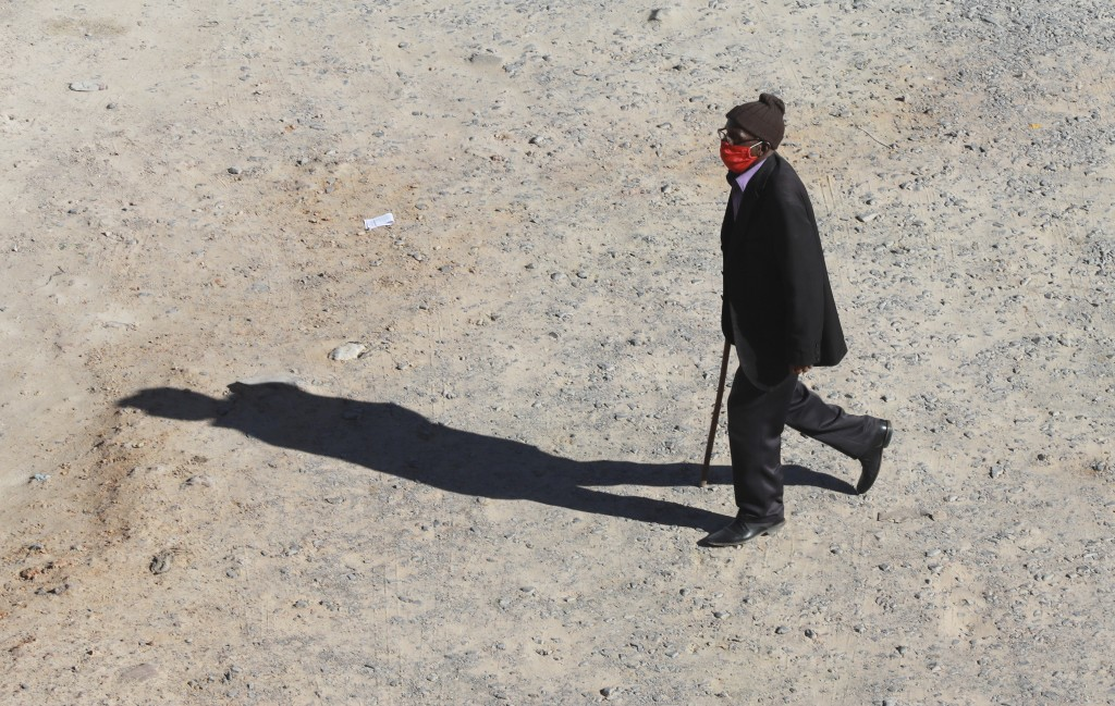 A man wears a mask to guard against coronavirus in Khayelitsha, Cape Town, South Africa, Tuesday, May 19, 2020. COVID-19 cases are spiking from India ...