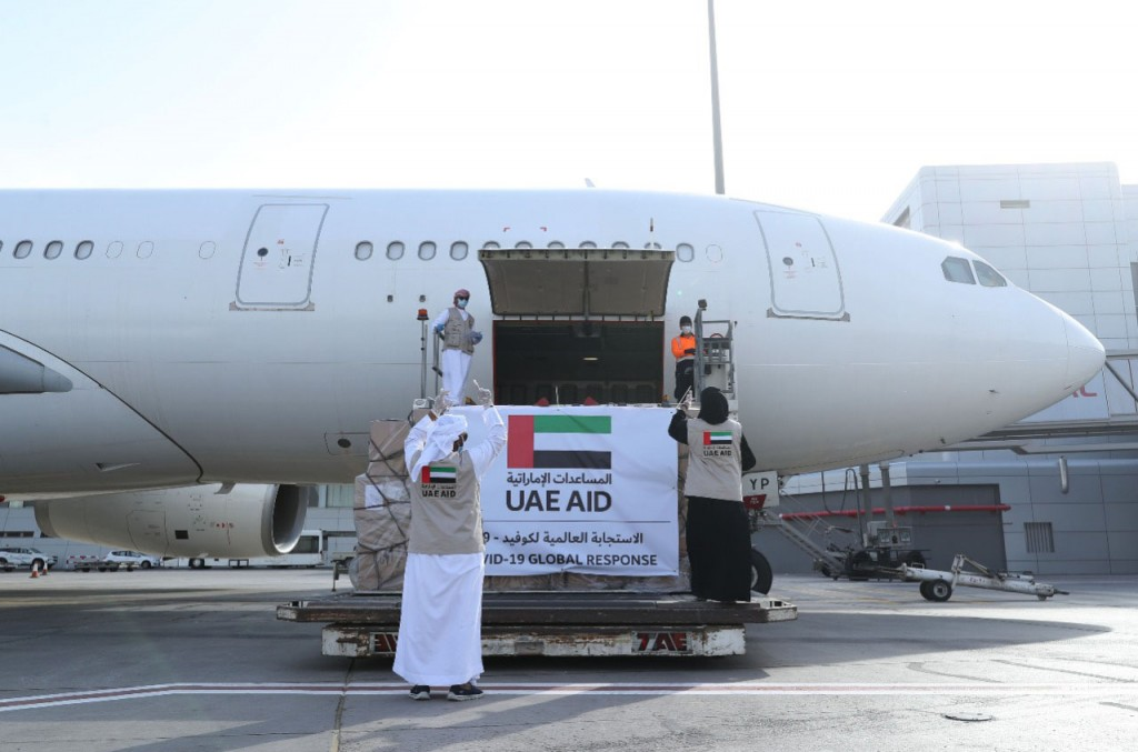 In this Tuesday, May 19, 2020 photo released by the state-run WAM news agency, an Etihad Airways flights loaded with aid for the Palestinians to fight...