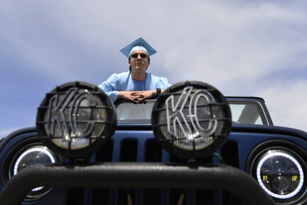 South River High School Class of 2020 senior Jackson Pedersen of Crofton, Md., waits for the start of a community-organized parade through Edgewater, ...