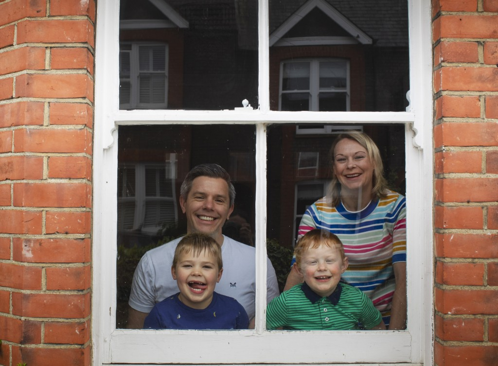 The Bowden family, Helen, Richard William and Tom look out from their window during the lockdown as they observe social distancing due to coronavirus ...
