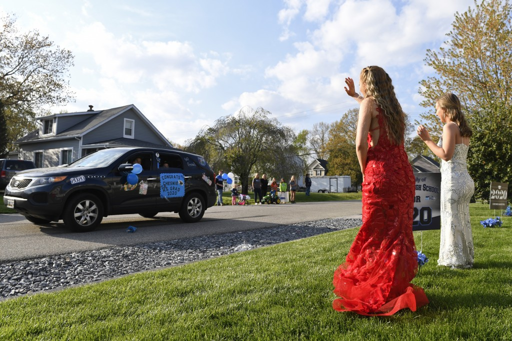 South River High School Class of 2020 seniors Chesnie Bell, second from right, and her best friend Meghan Wilborn, right, wear their prom dresses as t...