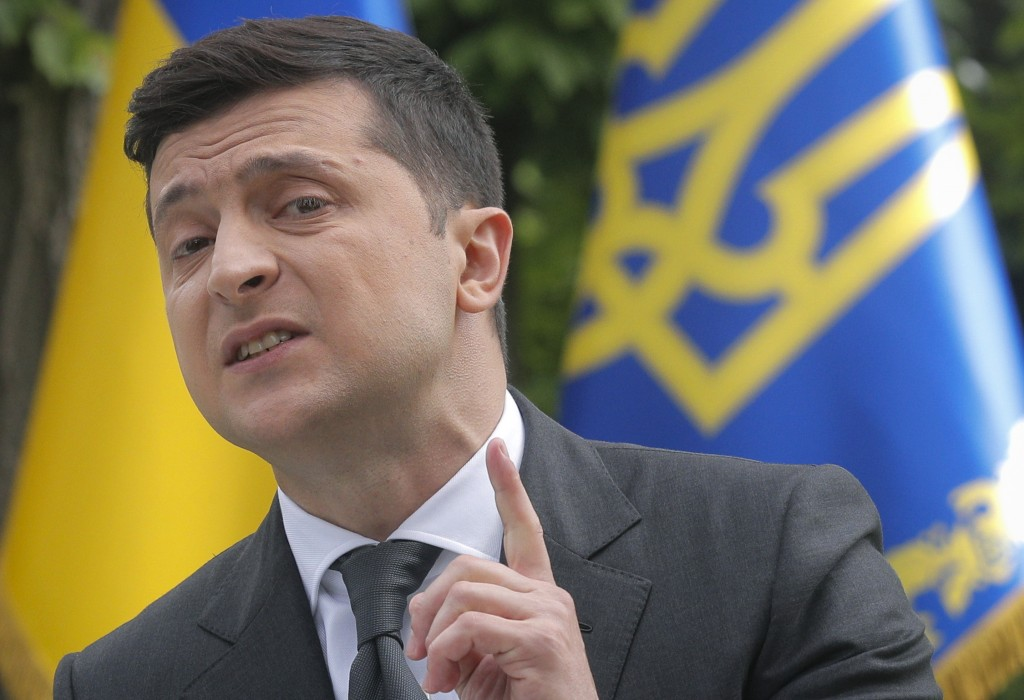 Ukraine's President Volodymyr Zelenskiy speaks to the media during a news conference in Kyiv, Ukraine, Wednesday, May 20, 2020. At the press conferenc...