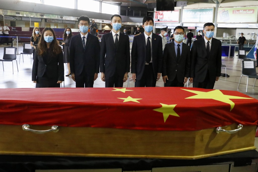 Chinese officials pay their respect in front of the flag-draped coffin of Ambassador Du Wei, who died at his home in the coastal city of Herzliya, dur...