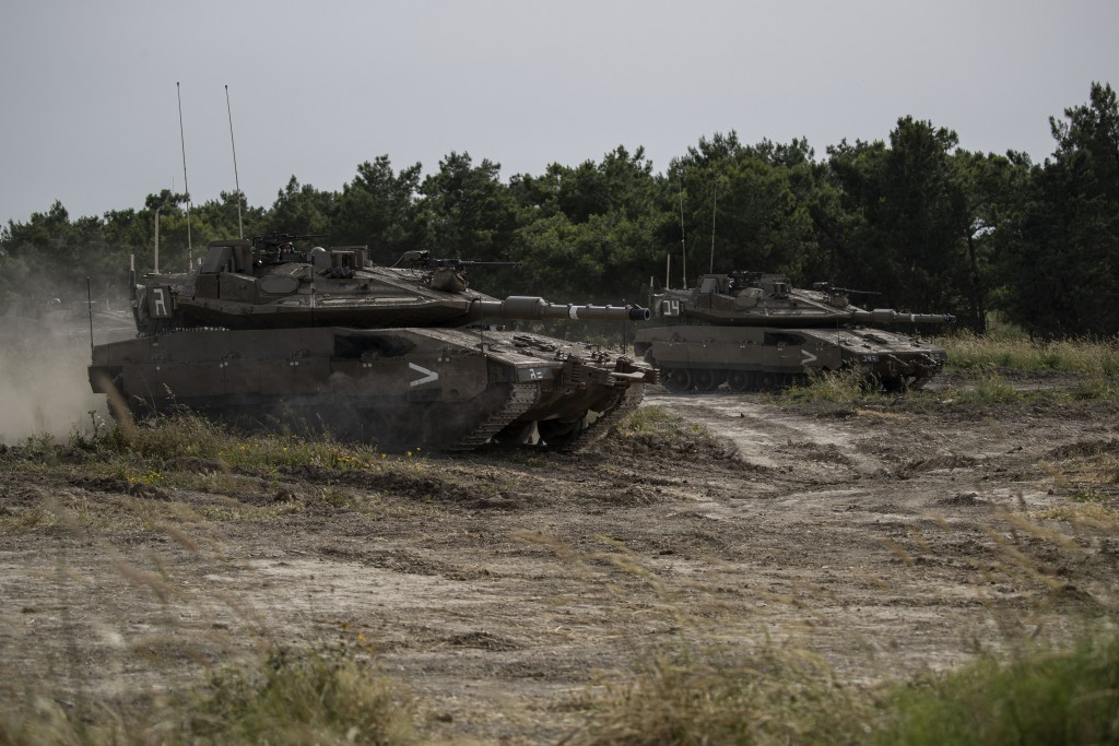 In this Wednesday, May 13, 2020 photo, the Israeli military conduct a drills in northern Israel. Twenty years after Hezbollah guerrillas pushed Israel...
