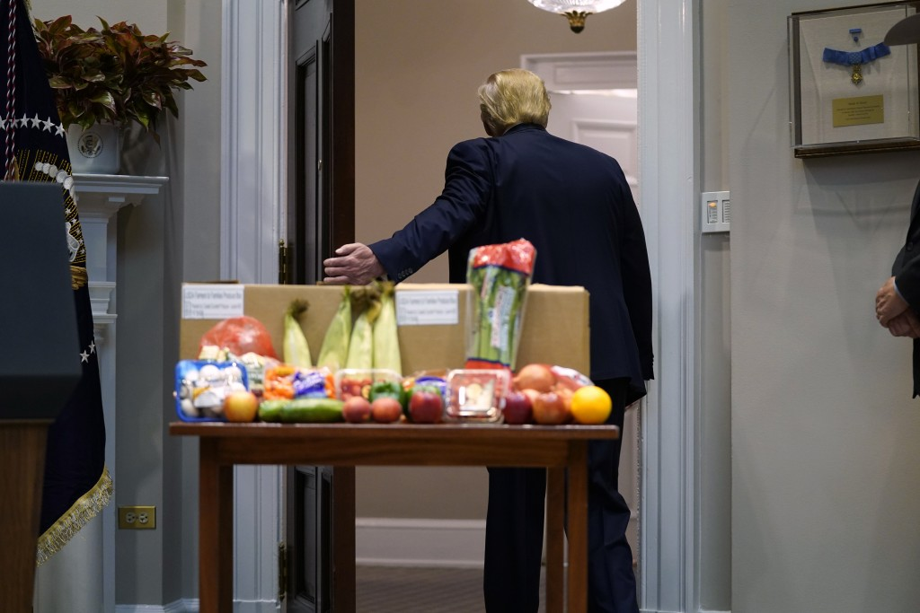 President Donald Trump leaves after an event on the food supply chain during the coronavirus pandemic, in the Roosevelt Room of the White House, Tuesd...