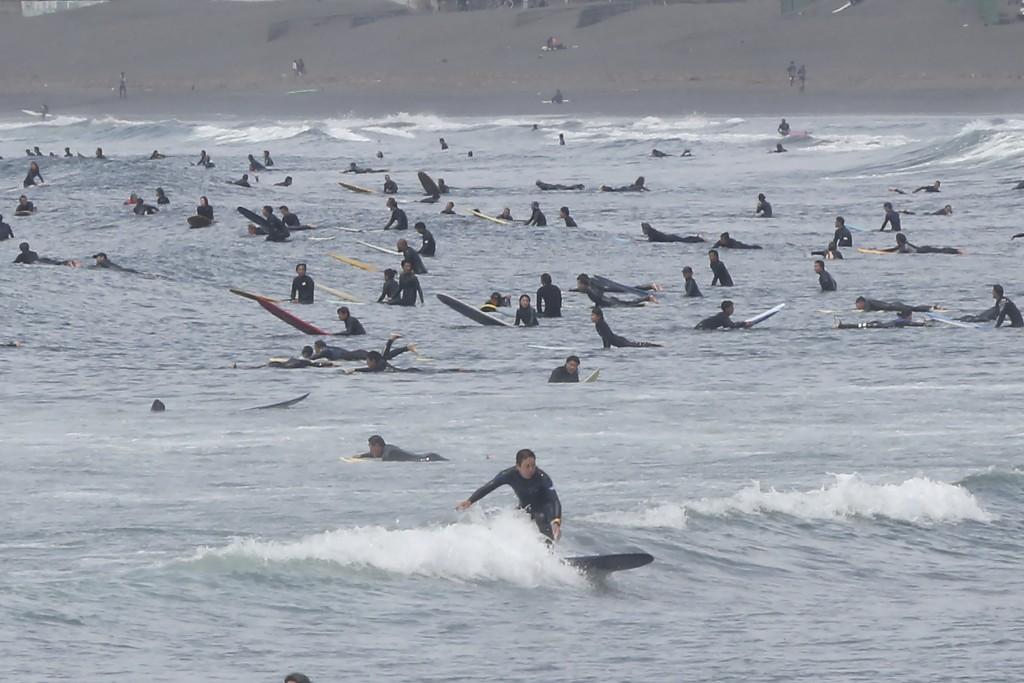 Surfers go surfing off Katase-kaigan beach in Fujisawa, Kanagawa prefecture, near Tokyo, April 21, 2020. While Kanagawa is still under a coronavirus s...