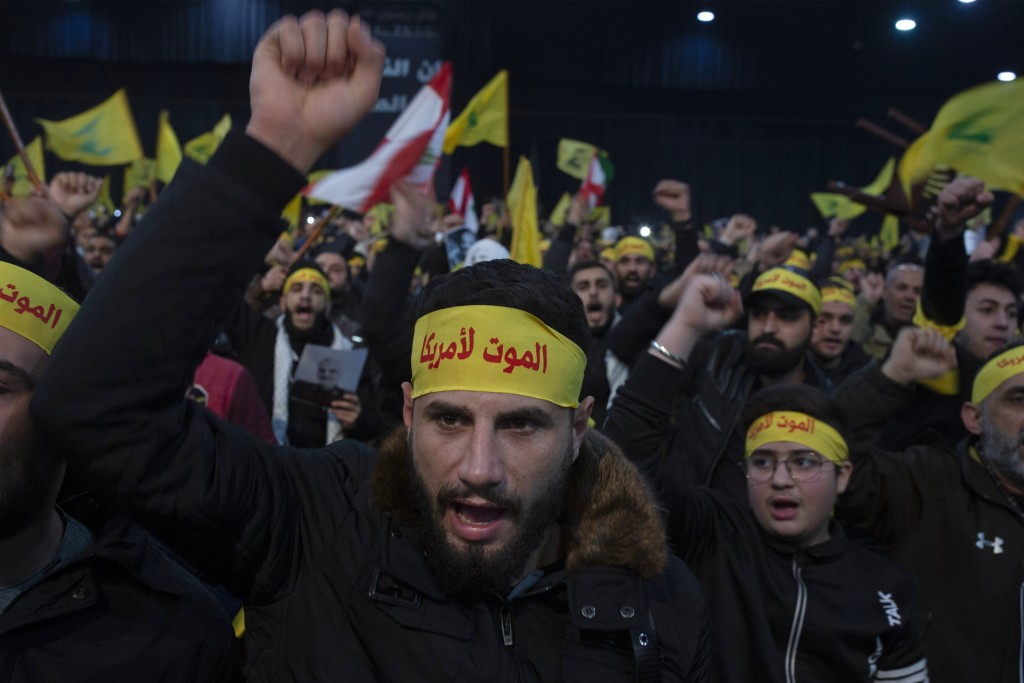 FILE - In this  Jan. 5, 2020 file photo, supporters of Hezbollah leader Sayyed Hassan Nasrallah chant slogans ahead of the leader's televised speech i...