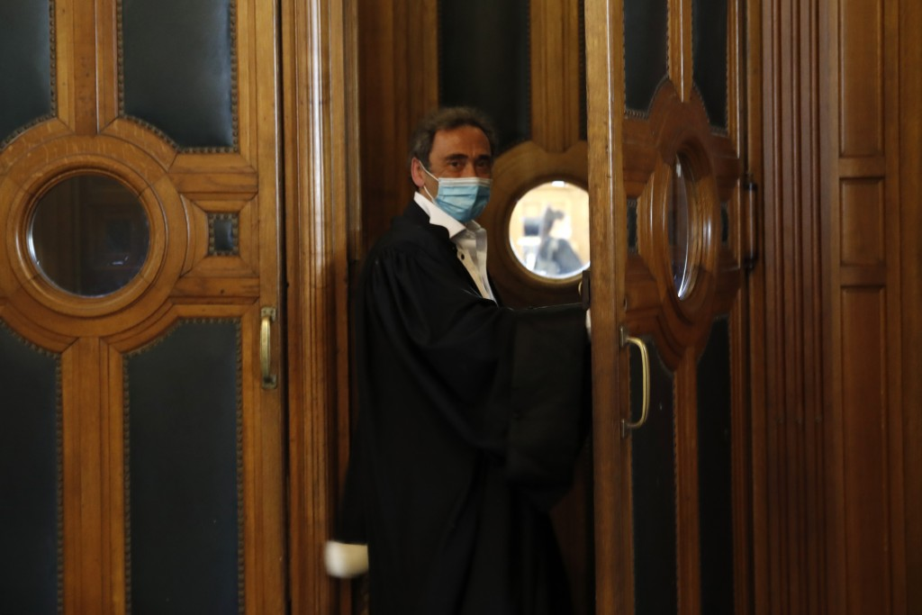 Laurent Bayon, one of Felicien Kabuga's French lawyers, wears a mask as he arrives in the courtroom Wednesday, May 20, 2020 in Paris. Felicien Kabuga,...