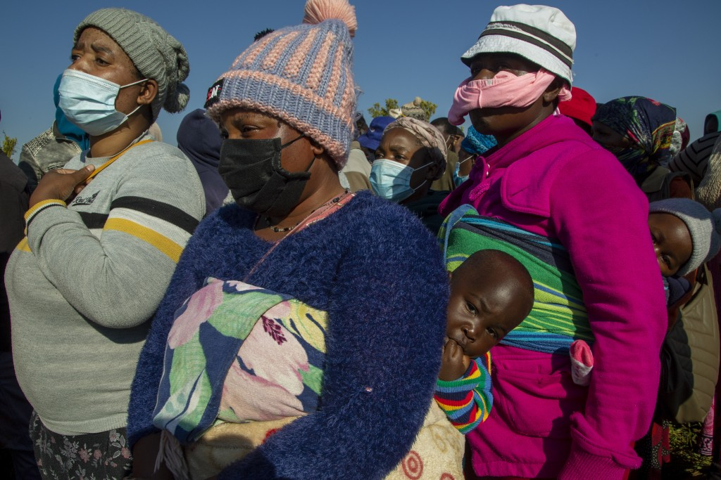 People affected by the coronavirus economic downturn, line up to receive food donations at the Iterileng informal settlement near Laudium, southwest o...