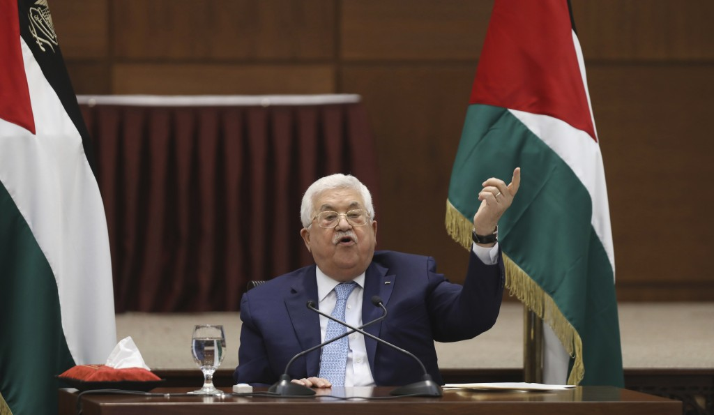 Palestinian President Mahmoud Abbas heads a leadership meeting at his headquarters, in the West Bank city of Ramallah, Tuesday, May 19, 2020. (Alaa Ba...