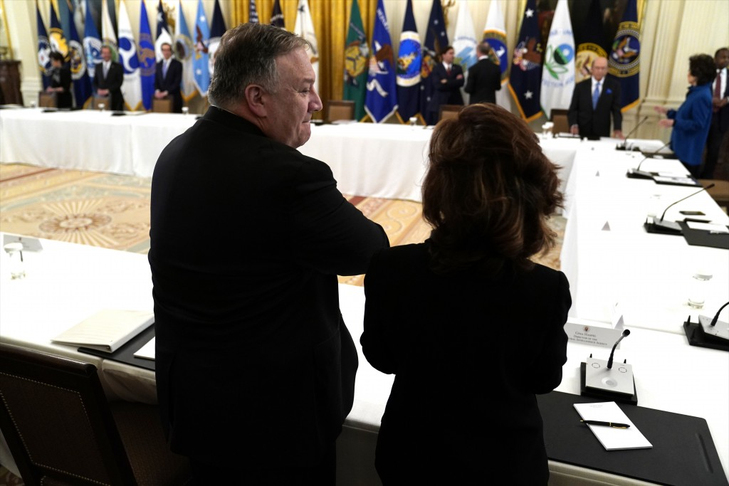 Secretary of State Mike Pompeo talks with CIA director Gina Haspel before President Donald Trump arrives for a Cabinet Meeting in the East Room of the...