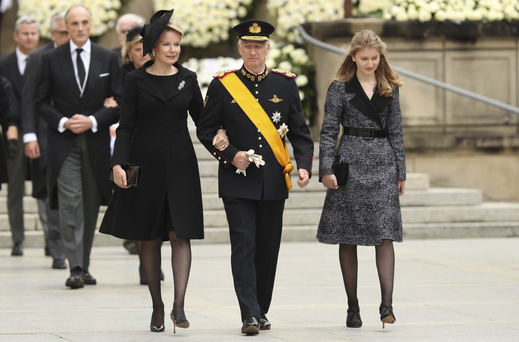 FILE - In this photo taken on Saturday, May 4, 2019, Belgium's King Philippe, center, the Queen Mathilde, center, and Crown Princess Elisabeth of Belg...
