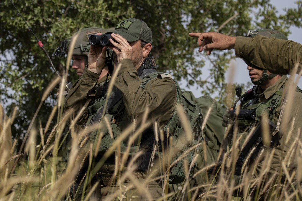 In this Wednesday, May 13, 2020 photo, Israeli troops take part in a drill in northern Israel. Twenty years after Hezbollah guerrillas pushed Israel's...