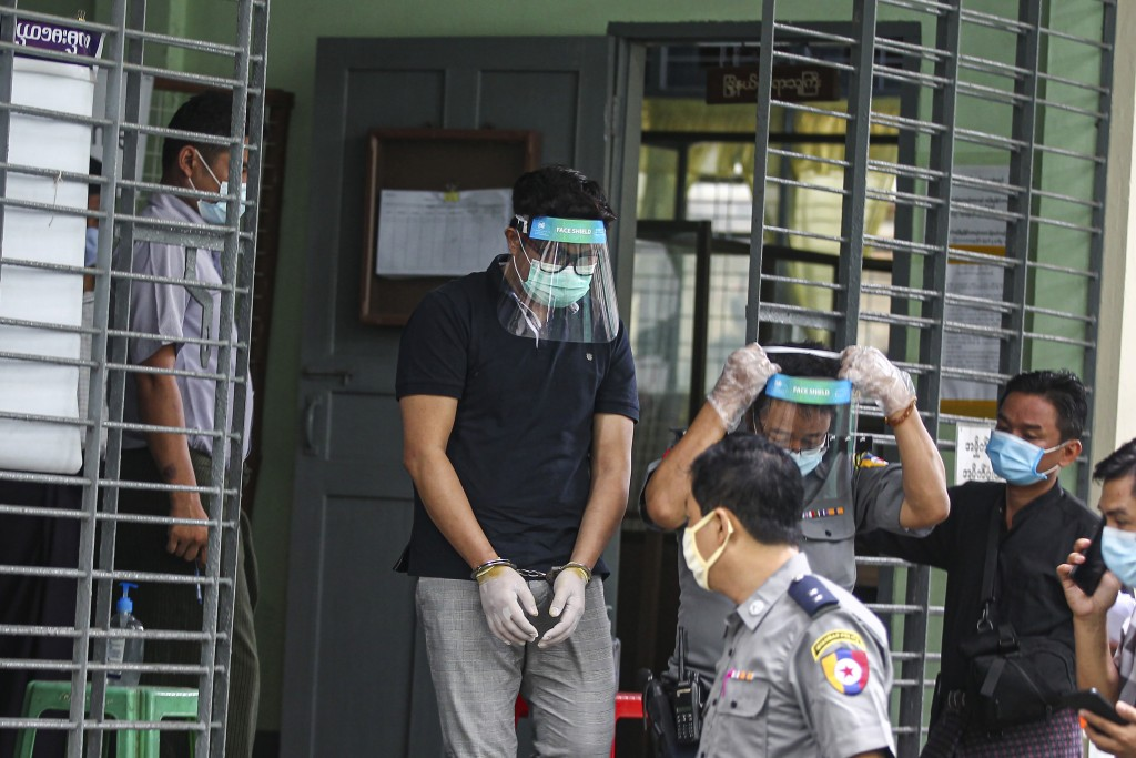 Canadian pastor David Lah covered with face shield and mask is escorted by police men as he leaves from a township court after his first court appeara...