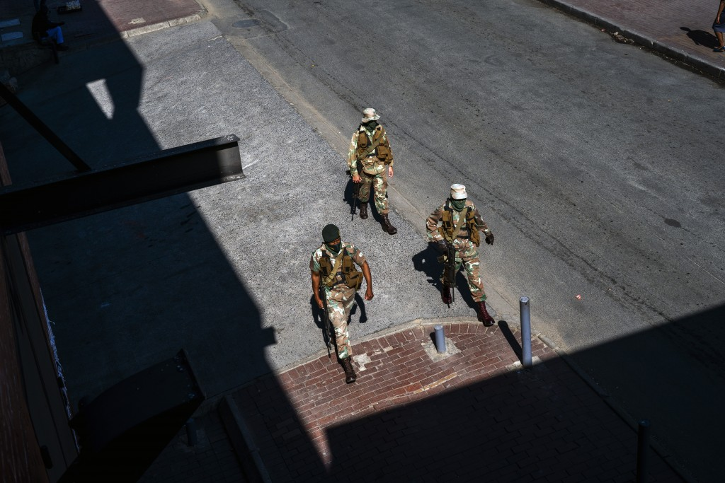 South African National Defense Forces patrol near the Pan Africa taxi rank in Johannesburg's Alexandra township,  Wednesday May 20, 2020, where a mass...