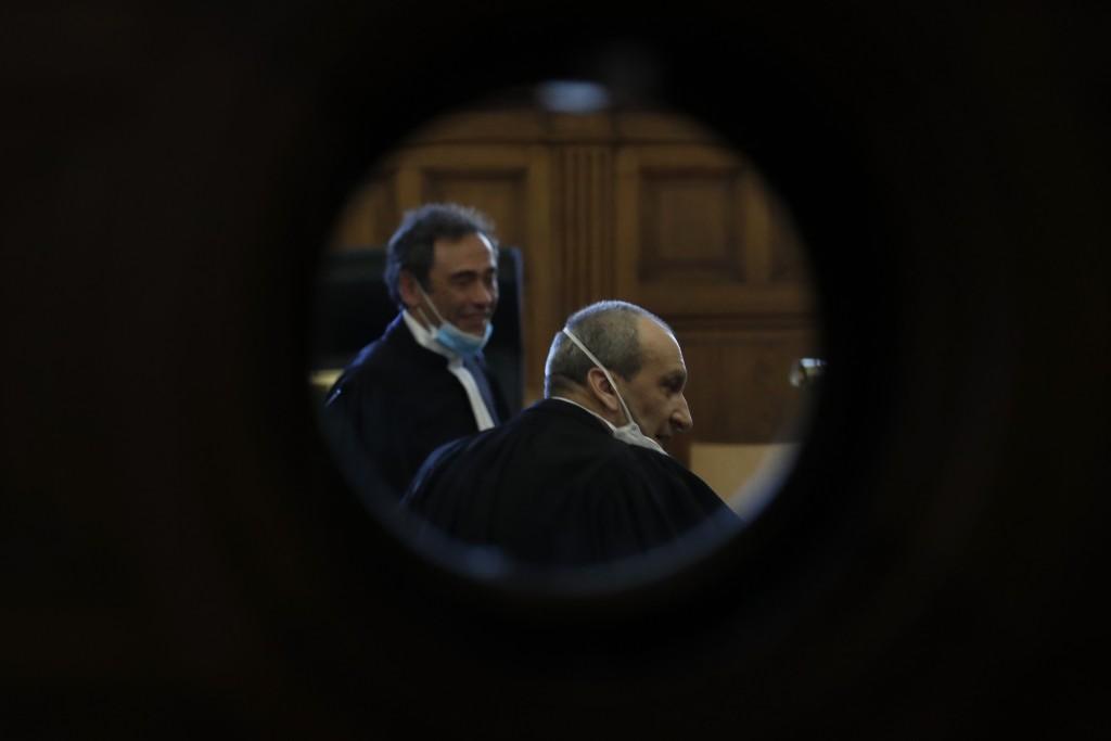 Lawyers Laurent Bayon, left, and Emmanuel Altit, defending Felicien Kabuga, wear masks in the courtroom Wednesday, May 20, 2020 in Paris. Felicien Kab...