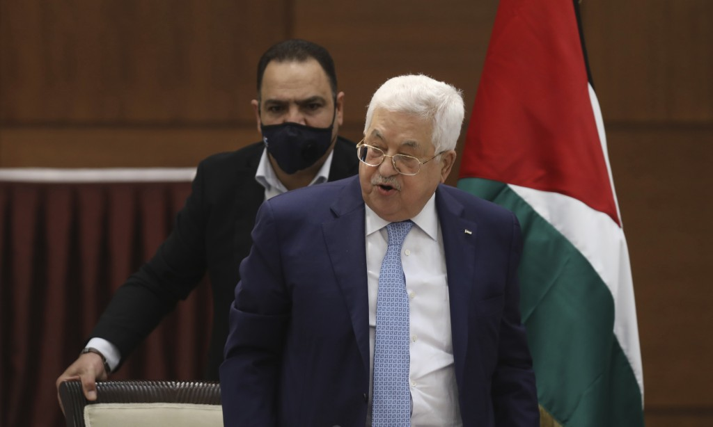 Palestinian President Mahmoud Abbas heads a leadership meeting at his headquarters in the West Bank city of Ramallah on Tuesday, May 19, 2020. (Alaa B...