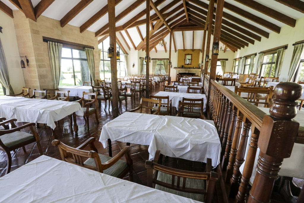 In this photo taken Friday, May 1, 2020, a dining room sits empty and devoid of tourists at the Ol Pejeta conservancy, in Kenya. Wildlife tourism is a...