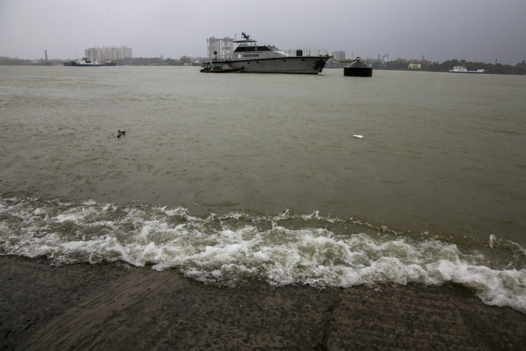 Water waves break on the banks of Hooghly River as an Indian Customs department ship is moored in the mid river in  Kolkata, India, Wednesday, May 20,...