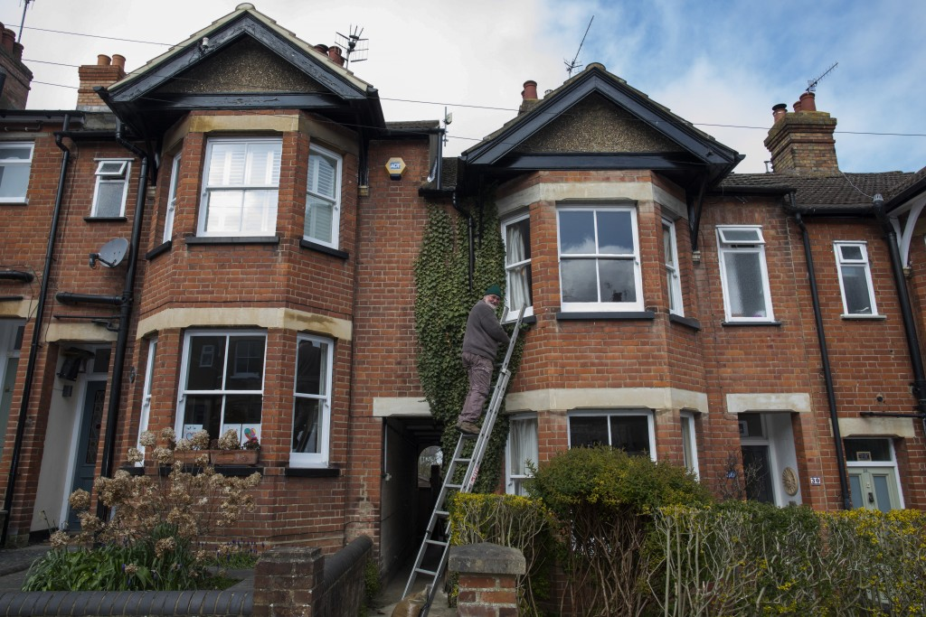 Bob works on his home during lockdown due to the coronavirus outbreak in Berkhamsted, England, Saturday, April 4, 2020. Bob Parsons and his wife Sue h...