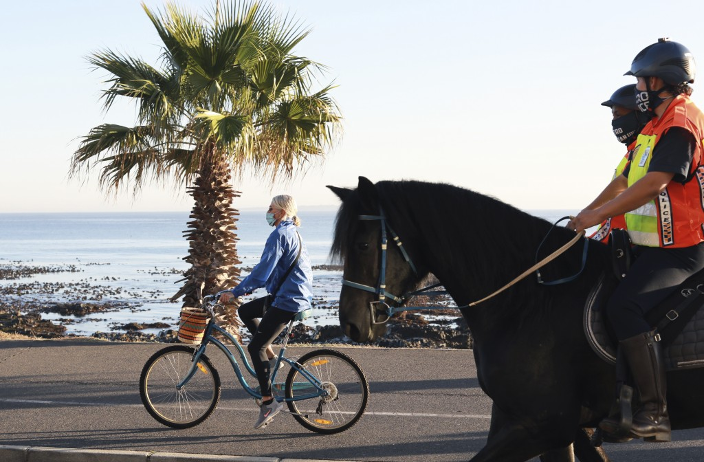 Police on horseback patrol along the promenade in Sea Point Cape Town, South Africa, Wednesday. May 20, 2020 as the country marked day 55 of a governm...