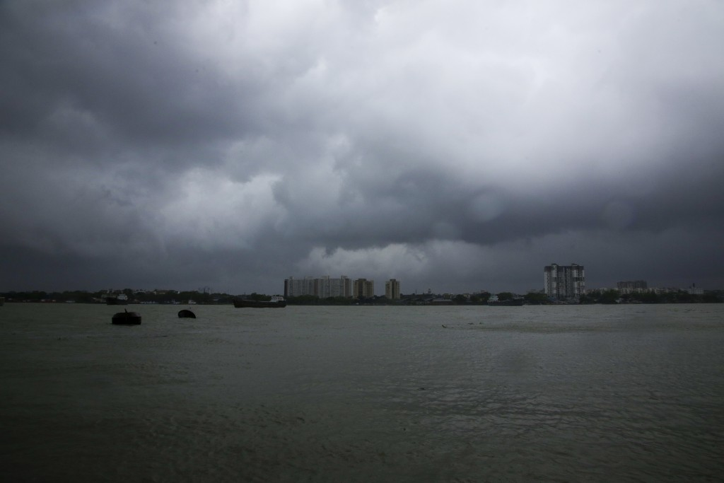 Rain clouds hover over the Hooghly River in Kolkata, India, Wednesday, May 20, 2020. Amphan, a powerful cyclone has slammed ashore along the coastline...