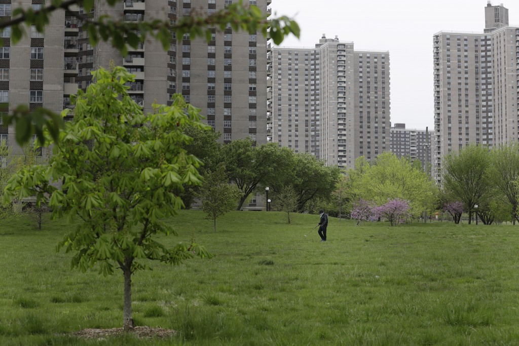 William Odem enjoys some golf on a field in Co-op City in the Bronx borough of New York, Wednesday, May 6, 2020. Within the Bronx, almost no place has...