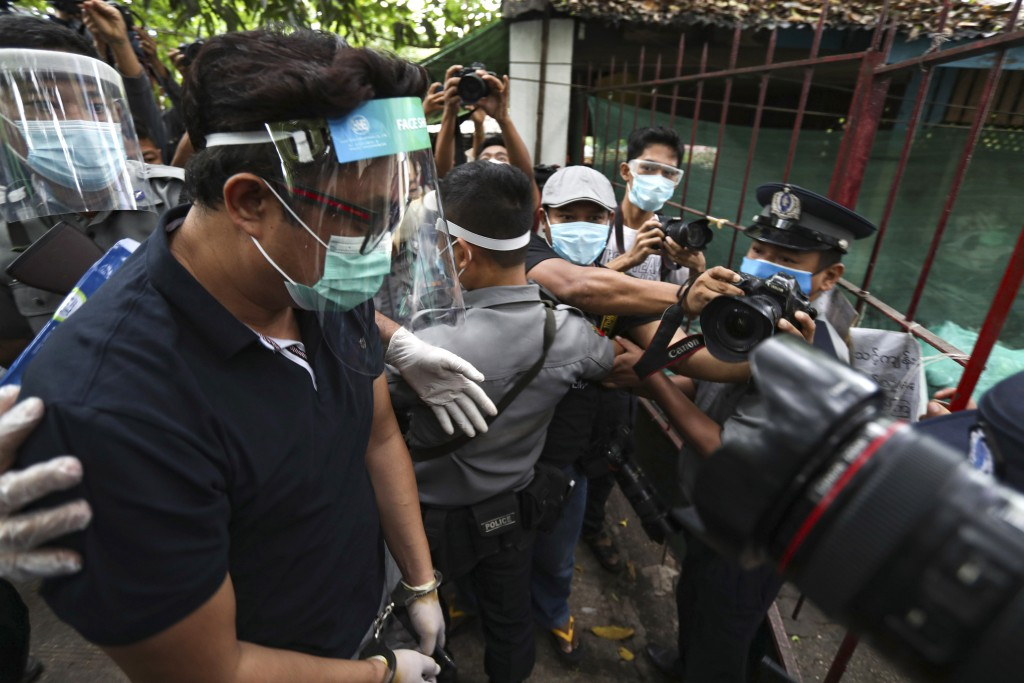 Canadian pastor David Lah, covered with face shield and mask, is escorted by police upon arrival at a township court for his first court appearance We...