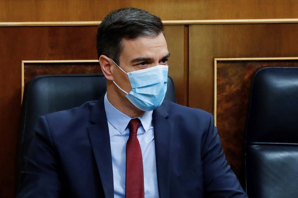 Spain's Prime Minister Pedro Sanchez sits in the Spanish parliament wearing a protective face mask in Madrid, Spain, Wednesday May 20, 2020. Sanchez i...
