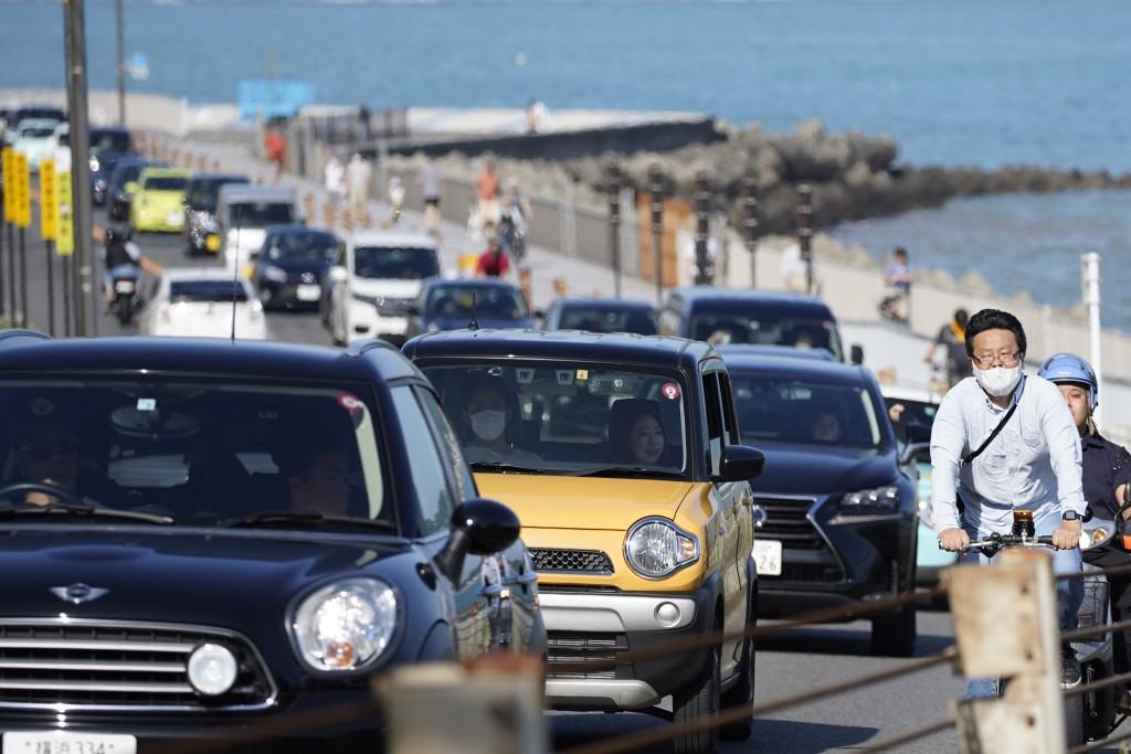 Cars are caught in traffic jam near a beach in Kamakura, Kanagawa prefecture, near Tokyo, Sunday, May 17, 2020. While Kanagawa is still under a corona...