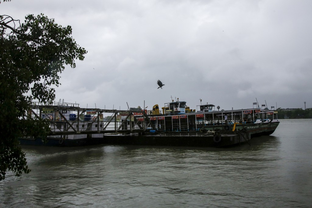 Passenger ferries tied up in a jetty on Hooghly River in  Kolkata, India, Wednesday, May 20, 2020. Amphan, a powerful cyclone has slammed ashore along...