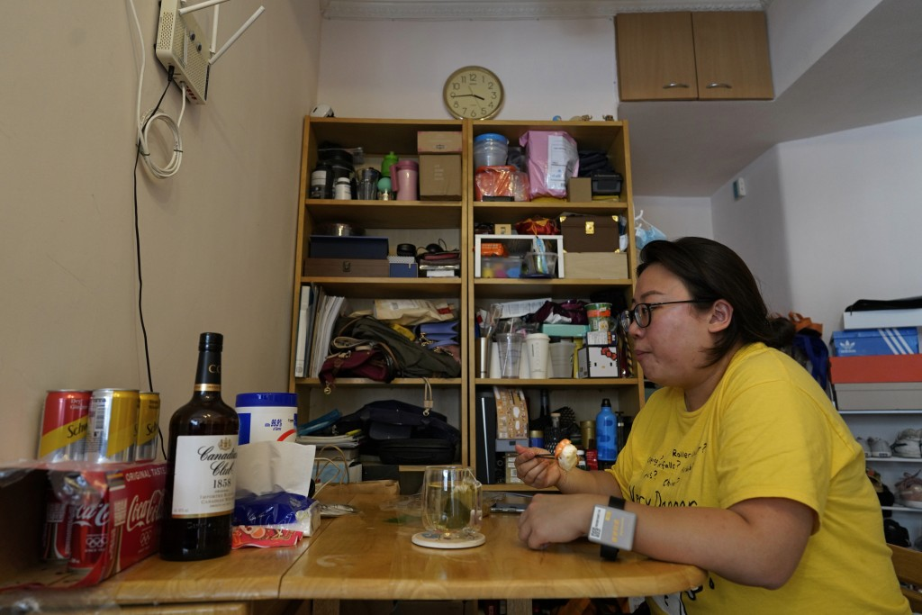 Associated Press reporter Zen Soo eats her lunch at the dining table at home while serving a two-week home quarantine in Hong Kong, April 17, 2020. Ho...
