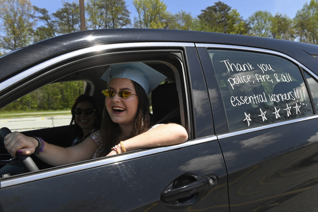 South River High School Class of 2020 senior Cheyenne Lustig of Crofton, Md., prepares to drive herself during a community-organized parade through Ed...