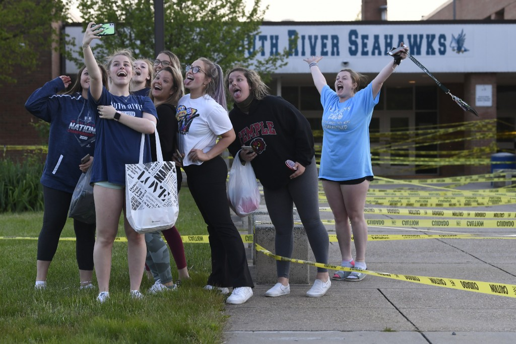 South River High School Class of 2020 seniors take a group photo after decorating their school during a senior prank at South River High School in Edg...