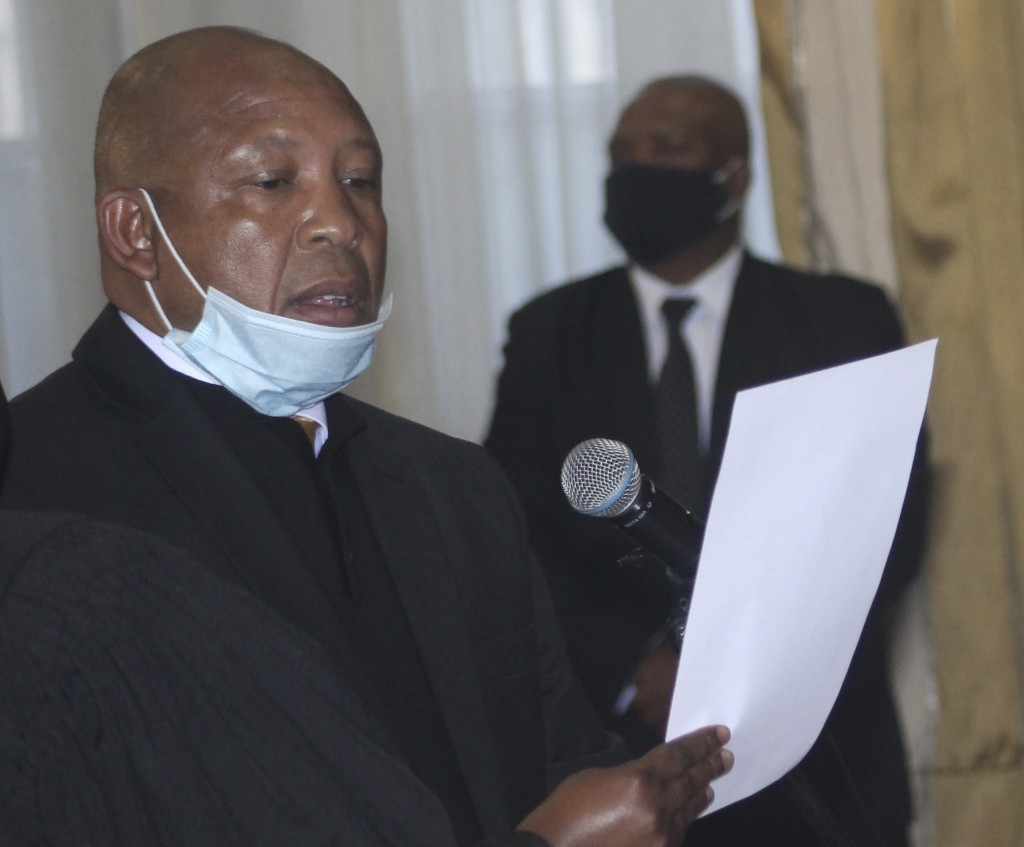 Lesotho's new Prime Minster Moeketsi Majoro is sworn in in Maseru, Lesotho, Wednesday, May 20, 2020. Majoro replaces outgoing Thomas Thabane who resig...